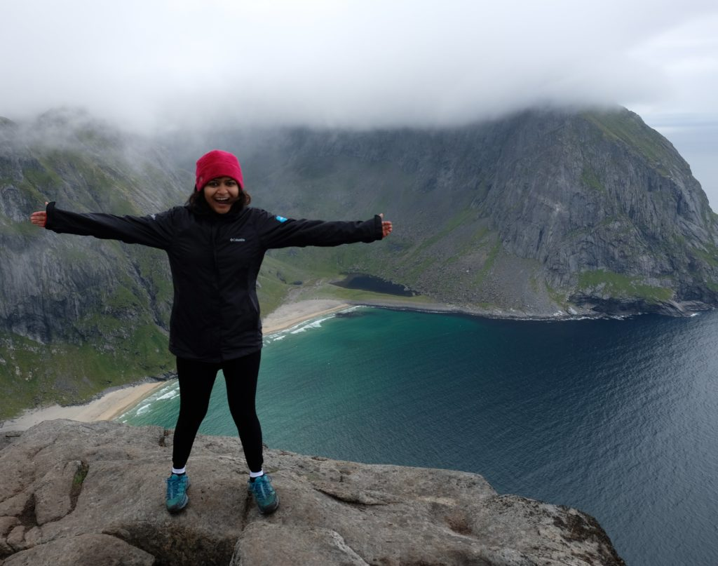 Photo: Astha Singhal standing on a mountain while hiking in Norway